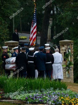 The flag-draped casket of President George H.W. Bush is carried to the burial plot close to his presidential library for internment, in College Station, Texas