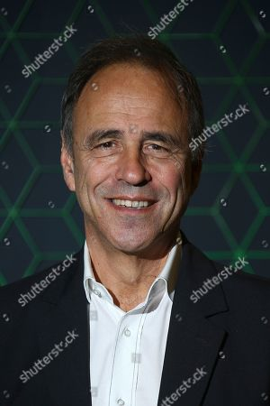 Anthony Horowitz posse for photographers upon arrival at the Bloomberg and Vanity Fair Gala Dinner in central London