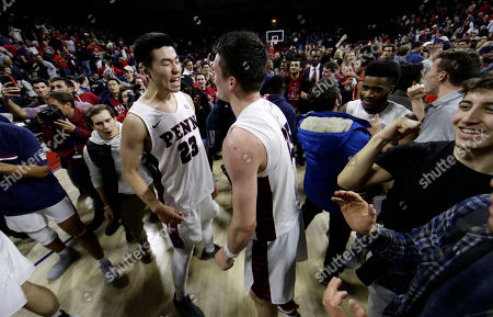 Michael Wang, AJ Brodeur. Penn's Michael Wang, left, and AJ Brodeur celebrate as students storm the court after Pennsylvania beat Villanova, 78-75, in an NCAA college basketball game, in Philadelphia