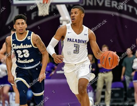 Furman's Mike Bothwell (3) brings the ball up the court while defended by Charleston Southern's Sean Price during the first half of an NCAA college basketball game, in Greenville, S.C