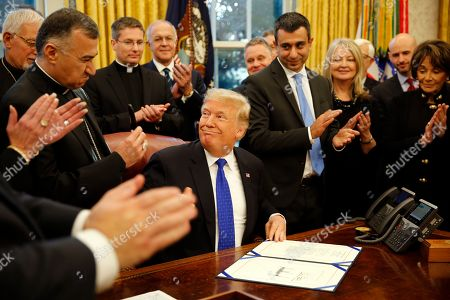 Editorial photo of Iraq and Syria Genocide Relief and Accountability Act signing, Washington DC, USA - 11 Dec 2018