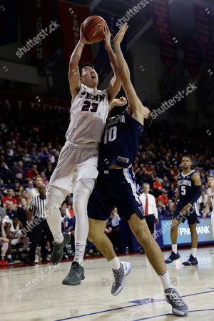 Pennsylvania's Michael Wang in action during an NCAA college basketball game against Villanova, in Philadelphia