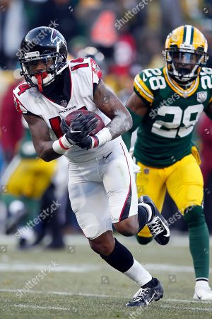 Atlanta Falcons wide receiver Justin Hardy (14) runs in for a touchdown after a catch against the Green Bay Packers during an NFL football game, in Green Bay, Wis. The Packers won 34-20