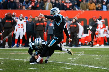 Carolina Panthers kicker Chandler Catanzaro (4) kicks a field goal out of the hold of Michael Palardy (5) against the Cleveland Browns during the second half of an NFL football game, in Cleveland