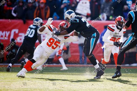 Cleveland Browns defensive end Myles Garrett (95) plays against Carolina Panthers offensive tackle Chris Clark (74) during the first half of an NFL football game, in Cleveland