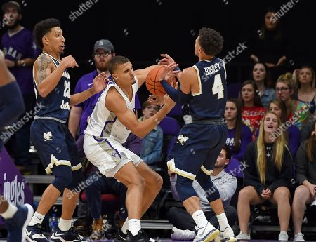 Deontaye Buskey, Sean Price. Furman's Jalen Slawson, center, battles for the ball with Charleston Southern's Deontaye Buskey, right, and Sean Price during the second half of an NCAA college basketball game, in Greenville, S.C