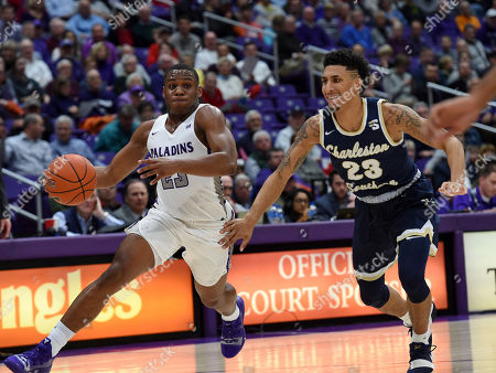 Jordan Lyons, Sean Price. Furman's Jordan Lyons, left, drives down the court while defended by Charleston Southern's Sean Price during the second half of an NCAA college basketball game, in Greenville, S.C. Furman won 77-69