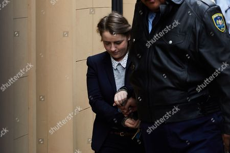 Stock Photo of Cathrina Cahill of Ireland is escorted after her sentencing in the Supreme Court in Sydney, Australia, 12 December 2018. Cathrina Cahill, 27, was sentenced to at least five years in jail for the manslaughter of her fiance, David Walsh.