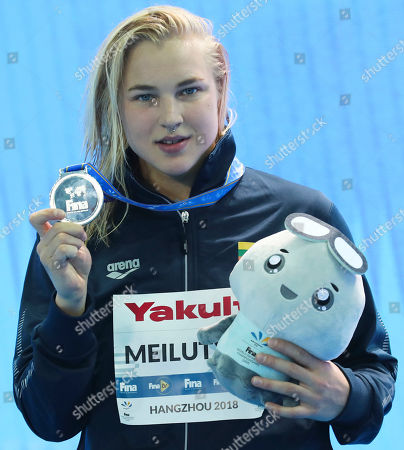 Silver medalist Lithuania's Ruta Meilutyte pose during ceremonies at the women's 50m breaststroke during the 14th FINA World Swimming Championships in Hangzhou, China