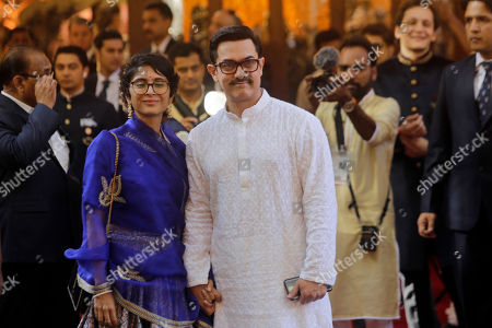 Bollywood actor Aamir Khan and his wife Kiran Rao arrive to attend the wedding of Isha Ambani, the daughter of Reliance Industries Chairman Mukesh Ambani, and Anand Piramal in Mumbai, India, . In a season of big Indian weddings, the Wednesday marriage of the scions of two billionaire families might be the biggest of them all. Isha is the Ivy League-educated daughter of industrialist Mukesh Ambani, thought to be India's richest man. The groom is the son of industrialist Ajay Piramal, thought to be worth $10 billion