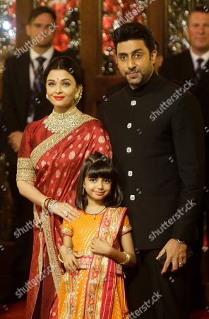 Stock Image of Abhishek Bachchan, Aishwarya Rai Bachchan. Indian Bollywood star Abhishek Bachchan, right, his wife Aishwarya Rai Bachchan and daughter Aaradhya arrive to attend the wedding of Isha Ambani, the daughter of Reliance Industries Chairman Mukesh Ambani, and Anand Piramal in Mumbai, India, . In a season of big Indian weddings, the Wednesday marriage of the scions of two billionaire families might be the biggest of them all. Isha is the Ivy League-educated daughter of industrialist Mukesh Ambani, thought to be India's richest man. The groom is the son of industrialist Ajay Piramal, thought to be worth $10 billion