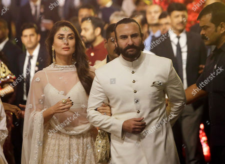 Bollywood actors Kareena Kapoor and Saif Ali Khan arrive to attend the wedding of Isha Ambani, the daughter of Reliance Industries Chairman Mukesh Ambani, and Anand Piramal in Mumbai, India, . In a season of big Indian weddings, the Wednesday marriage of the scions of two billionaire families might be the biggest of them all. Isha is the Ivy League-educated daughter of industrialist Mukesh Ambani, thought to be India's richest man. The groom is the son of industrialist Ajay Piramal, thought to be worth $10 billion