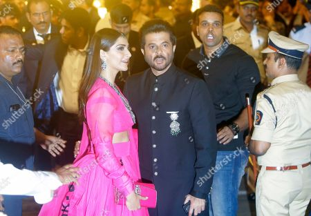 Bollywood actor Anil Kapoor and his daughter Sonam Kapoor arrive to attend the wedding of Isha Ambani, the daughter of Reliance Industries Chairman Mukesh Ambani, and Anand Piramal in Mumbai, India, . In a season of big Indian weddings, the Wednesday marriage of the scions of two billionaire families might be the biggest of them all. Isha is the Ivy League-educated daughter of industrialist Mukesh Ambani, thought to be India's richest man. The groom is the son of industrialist Ajay Piramal, thought to be worth $10 billion