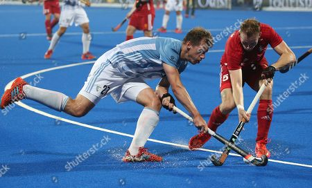 Argentina?s Lucas Rossi  (L) in action against David Ames (R) of England during the quarter final match between Argentina and England at the men's Field Hockey World Cup in Bhubaneswar, India, 12 December 2018.