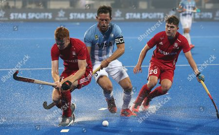 England?s David Ames (L) in action against Pedro Ibarra (C) of Argentina during the quarter final match between Argentina and England at the men's Field Hockey World Cup in Bhubaneswar, India, 12 December 2018.
