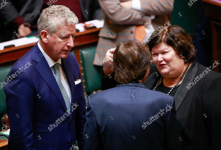 Stock Photo of Belgium's Minister of Interior Affairs and Foreign Trade Pieter De Crem (L) and Minister of Health, Social Affairs, Asylum Policy and Migration Maggie De Block (R) during a special plenary session of the chamber at the federal parliament in Brussels, Belgium, 12 December 2018. On 09 December, Belgium's New Flemish Alliance (N-VA) ministers resigned from the government because of the UN migration pact. They were replaced by other members of the government, that does not have the majority in parliament anymore.