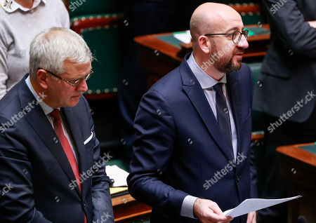 Vice-Prime Minister and Minister of Employment, Economy, Consumer Affairs and equal chances Kris Peeters (L) and Belgian Prime Minister Charles Michel during a special plenary session of the chamber at the federal parliament in Brussels, Belgium, 12 December 2018. On 09 December, Belgium's New Flemish Alliance (N-VA) ministers resigned from the government because of the UN migration pact. They were replaced by other members of the government, that does not have the majority in parliament anymore.