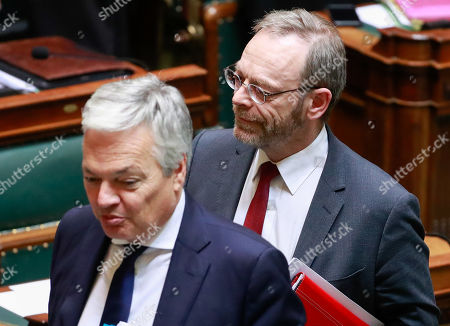 Belgium's Vice-Prime Minister and Minister of Foreign Affairs and Defence Didier Reynders (L) and N-VA's head of group Peter De Roover arrive for a special plenary session of the chamber at the federal parliament in Brussels, Belgium, 12 December 2018. On 09 December, Belgium's New Flemish Alliance (N-VA) ministers resigned from the government because of the UN migration pact. They were replaced by other members of the government, that does not have the majority in parliament anymore.