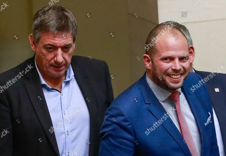 Belgian former Interior Minister Jan Jambon (L) and former Secretary of State for Asylum, Migration and Administrative Simplification Theo Francken (R) arrives at a special plenary session of the chamber at the federal parliament in Brussels, Belgium, 12 December 2018. On 09 December, Belgium's New Flemish Alliance (N-VA) ministers resigned from the government because of the UN migration pact. They were replaced by other members of the government, that does not have the majority in parliament anymore.