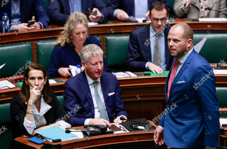 Stock Photo of Belgian former Secretary of State for Asylum and Migration Theo Francken (R) arrives at a special plenary session of the chamber at the federal parliament in Brussels, Belgium, 12 December 2018. On 09 December, Belgium's New Flemish Alliance (N-VA) ministers resigned from the government because of the UN migration pact. They were replaced by other members of the government, that does not have the majority in parliament anymore.