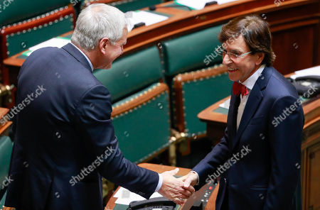 Vice-Prime Minister and Minister of Employment, Economy, Consumer Affairs and equal chances Kris Peeters (L) and Former Prime Minister (PS) Elio Di Rupo during a special plenary session of the chamber at the federal parliament in Brussels, Belgium, 12 December 2018. On 09 December, Belgium's New Flemish Alliance (N-VA) ministers resigned from the government because of the UN migration pact. They were replaced by other members of the government, that does not have the majority in parliament anymore.