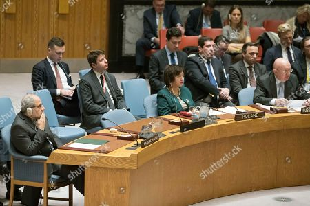 Vassily Nebenzia, Eshagh Al-Habib. Iranian Deputy Ambassador to the United Nations Eshagh Al-Habib, left, listens as Russian Ambassador to the United Nations Vassily Nebenzia speaks during a Security Council meeting on Iran's compliance with the 2015 nuclear agreement, at United Nations headquarters