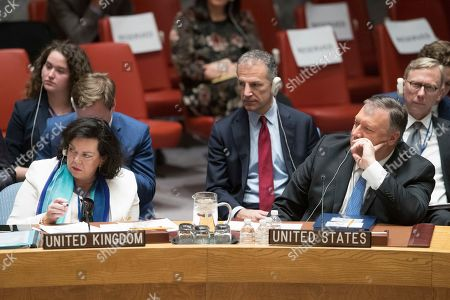 Mike Pompeo, Karen Pierce. U.S. Secretary of State Mike Pompeo, right, and British Ambassador to the United Nations Karen Pierce listen as Russian Ambassador to the United Nations Vassily Nebenzia speaks during a Security Council meeting on Iran's compliance with the 2015 nuclear agreement, at United Nations headquarters