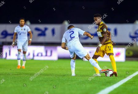 Stock Image of Al-Hilal's Mohammed Al-Breik (C) in action against Ohod's Sami Kassar (R) during the Saudi Professional League soccer match between Ohod Club and Al-Hilal S. FC in Medina, Saudi Arabia, 12 December 2018.
