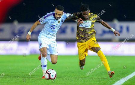 Al-Hilal's Mohammed Al-Breik (L) in action against Ohod's Sami Kassar (R) during the Saudi Professional League soccer match between Ohod Club and Al-Hilal S. FC in Medina, Saudi Arabia, 12 December 2018.
