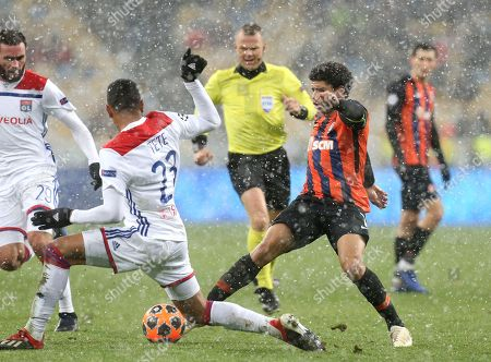 Lyon's Kenny Tete, left, challenges for the ball with Shakhtar Taison during the Group F Champions League soccer match between Shakhtar Donetsk and Lyon at the Olympiyskiy stadium, in Kiev, Ukraine, Wednesday, Dec.12, 2018