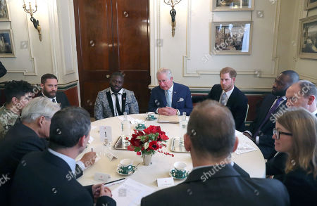 Actor Tom Hardy (2nd left) Prince Charles and Prince Harry (4th and 5th left) during a discussion about violent youth crime at a forum held at Clarence House in London.
