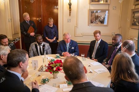 Actor Tom Hardy (left) sits next to Prince Charles and Prince Harry, during a discussion about violent youth crime at a forum held at Clarence House in London.