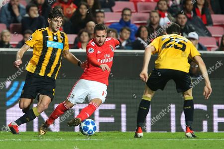 Benfica's Andrija Zivkovic, center, vies the ball past AEK's Kostas Galanopoulos, right, and AEK's Lucas Boye, left, during the Champions League group E soccer match between Benfica and AEK Athens at the Luz stadium in Lisbon