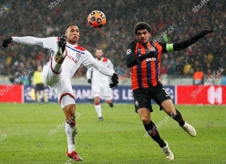 Kenny Tete (L) of Lyon in action against Taison (R) of Shakhtar during the UEFA Champions League group F soccer match between Shakhtar Donetsk and Olympique Lyon in Kiev, Ukraine, 12 December 2018.