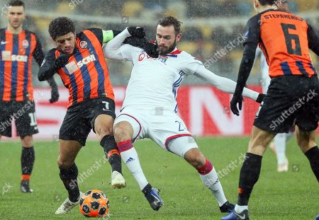 Lucas Tousart (C) of Lyon in action against Taison (L) of Shakhtar during the UEFA Champions League group F soccer match between Shakhtar Donetsk and Olympique Lyon in Kiev, Ukraine, 12 December 2018.