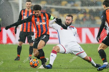 Lucas Tousart (R) of Lyon in action against Taison (L) of Shakhtar during the UEFA Champions League group F soccer match between Shakhtar Donetsk and Olympique Lyon in Kiev, Ukraine, 12 December 2018.