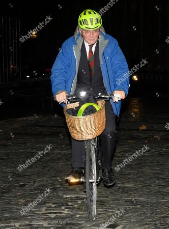 Andrew Mitchell MP seen leaving the Houses of Parliament in Westminster