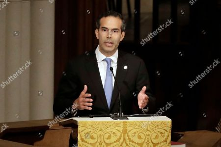 George P. Bush pauses as he gives a eulogy during a funeral for former President George H.W. Bush at St. Martin's Episcopal Church, in Houston