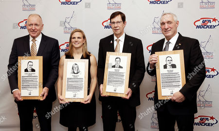 David Poile, Red Berenson, Natalie Darwitz, Paul Stewart. From left, former Michigan coach Red Berenson, three-time Olympic medalist Natalie Darwitz, Nashville Predators general manager David Poile and retired NHL hockey referee Paul Stewart pose with their plaques before being inducted into the U.S. Hockey Hall of Fame, in Nashville, Tenn