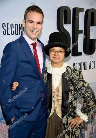 "Alan Aisenberg, Charlyne Yi. Actors Alan Aisenberg, left, and Charlyne Yi attend the world premiere of ""Second Act"" at Regal Union Square Stadium 14, in New York"