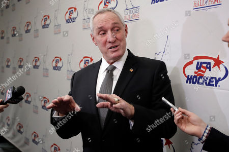 Retired NHL referee Paul Stewart answers questions before being inducted into the U.S. Hockey Hall of Fame, in Nashville, Tenn