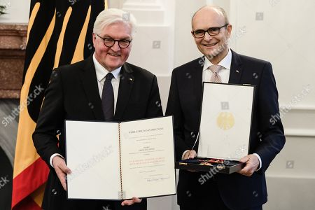 German President Frank-Walter Steinmeier (L) and the former Premier of the Mecklenburg-Western Pomerania state, Erwin Sellering (R), pose with the German Order of Merit during a ceremony in Berlin, Germany, 13 December 2018. German President Frank-Walter Steinmeier during a ceremony awarded the Order of Merit to Premier of Hesse Volker Bouffier, the former Premier of North Rhine-Westphalia Hannelore Kraft, the former Premier of Mecklenburg-Western Pomerania Erwin Sellering and the former Premier of Saxony Stanislaw Tillich.