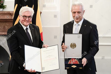 German President Frank-Walter Steinmeier (L) and the former Premier of the Saxony state, Stanislaw Tillich (R), pose with the German Order of Merit during a ceremony in Berlin, Germany, 13 December 2018. German President Frank-Walter Steinmeier during a ceremony awarded the Order of Merit to Premier of Hesse Volker Bouffier, the former Premier of North Rhine-Westphalia Hannelore Kraft, the former Premier of Mecklenburg-Western Pomerania Erwin Sellering and the former Premier of Saxony Stanislaw Tillich.