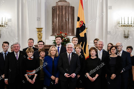 The Premier of Hesse Volker Bouffier (2-L), the former Premier of North Rhine-Westphalia Hannelore Kraft (5-L), German President Frank-Walter Steinmeier (6-L), the wife of German President Frank-Walter Steinmeier Elke Buedenbender (7-L), the former Premier of Saxony Stanislaw Tillich (9-L) and  the former Premier of Mecklenburg-Western Pomerania Erwin Sellering (11-L) pose with family members after a ceremony of German Order of Merit in Berlin, Germany, 13 December 2018. German President Frank-Walter Steinmeier during a ceremony awarded the Order of Merit to Premier of Hesse Volker Bouffier, the former Premier of North Rhine-Westphalia Hannelore Kraft, the former Premier of Mecklenburg-Western Pomerania Erwin Sellering and the former Premier of Saxony Stanislaw Tillich.