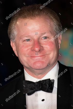 David Magee poses for photographers upon arrival at the 'Mary Poppins Returns' premiere in London