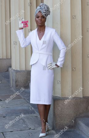 Stock Photo of Singer Niomi Daley (Ms. Dynamite) with her award after an Investiture at Buckingham Palace in London