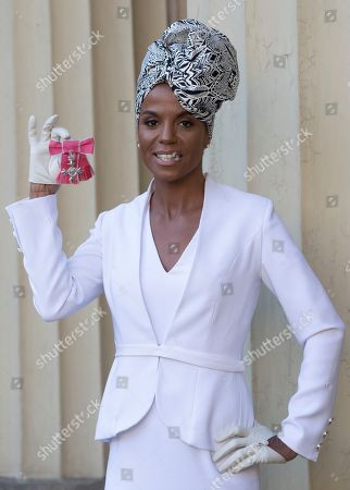Stock Image of Singer Niomi Daley (Ms. Dynamite) with her award after an Investiture at Buckingham Palace in London