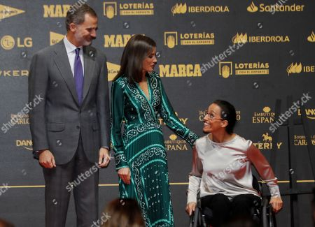 King Felipe VI of Spain (L) and Queen Letizia (C) chat with paralympic swimmer Teresa Perales (R) as they attend the Spanish sports newspaper Marca 80th anniversary celebrations in Madrid, Spain, 13 December 2018.