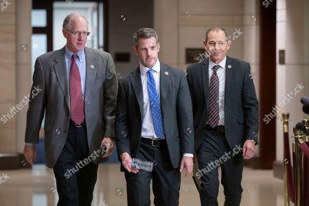Mike Conaway, Adam Kinzinger, John Curtis. House Agriculture Committee Chairman Mike Conaway, R-Texas, Rep. Adam Kinzinger, R-Ill., and Rep. John Curtis, R-Utah, walk to a classified security briefing on the murder of Jamal Khashoggi and Saudi Arabia's war in Yemen, on Capitol Hill in Washington