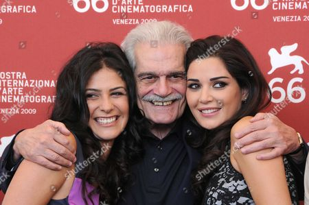 Actor Omar Sharif (C) and actress Cyrine Abdel Nour (R) and Basma Hassan.